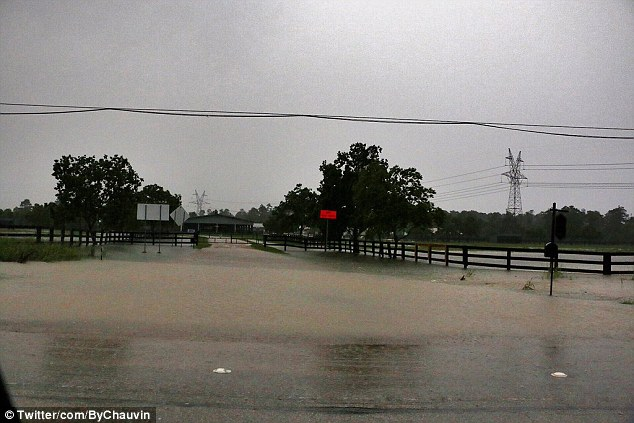 One person died in Chappell Hill, not far from Brenham, in a flooded mobile home. Four people remain missing across the state. Pictured, flooding in Magnolia, Texas