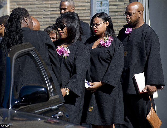 Carey was shot to death by police after trying to ram her vehicle through a White House barrier (her sisters mourned at today's funeral)