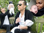 Daddy duties: Wissam Al Mana, 42, was spotted taking their baby boy Eissa for a stroll around a London park in Belgravia on Saturday
