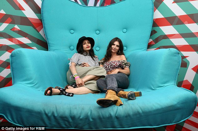 Lounging around: Freida caught up with actress Emily Ratajkowski inside the tent.The two women reclined on a giant aqua blue chair