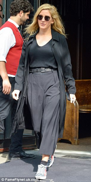 Here they come: Ellie Gouldingwas once again joined by new man Casper Jopling as they emerged from a Manhattan hotel with their luggage on Thursday afternoon