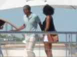 Michelle and Barack Obama pose for a photograph on the upper deck of billionaire music mogul David Geffen's superyacht on Friday as the former First Couple carried on their Tahitian vacation off the island of Mo'orea