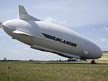 The £25million Airlander 10, pictured, 'nosedived' into a field in Bedfordshire today after its rear moorings came loose