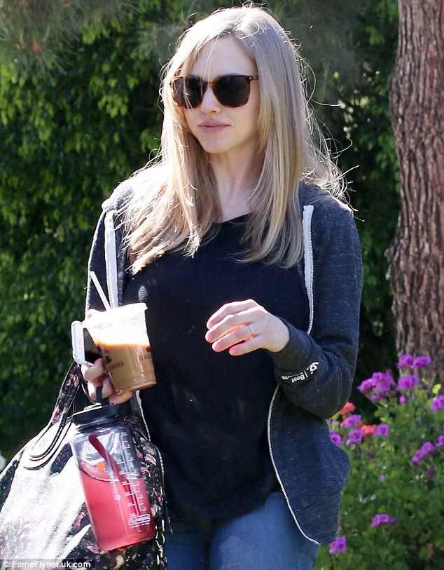 Wedding ring: Amanda Seyfried showed her simple wedding ring Thursday while running errands with new husband Thomas Sadoski in Los Angeles