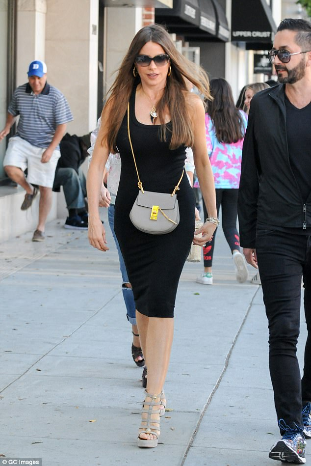 Little Balck Wow:Sofia Vergara threw on a classic little black dress to head to lunch in Beverly Hills, California, on Thursday and looked spectacular doing so