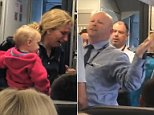 The video shows a woman with a child in her arms after allegedly being hit with a stroller on the flight