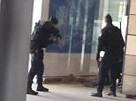 Police were seen leading a man away at the Gare du Nord station in Paris this afternoon