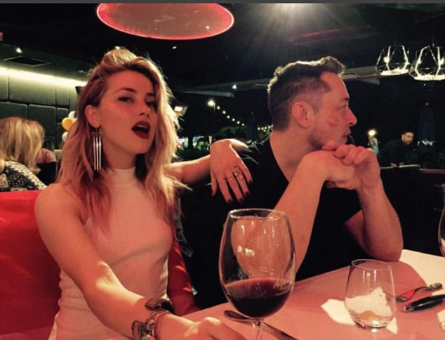 'Cheeky':Amber Heard has seemingly confirmed her relationship with Elon Musk on Instagram Sunday, as the 35-year-old star's dark red lipstick could be seen on the billionaire's cheek
