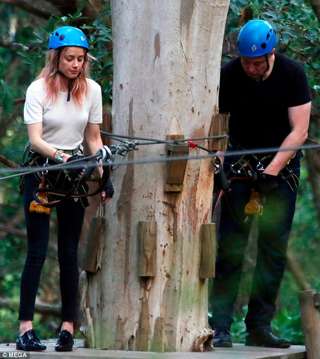 Fun and games:Earlier in the day, the pair were spotted putting on a loved up display at the Currumbin Wildlife Sanctuary as they even zip-lined together