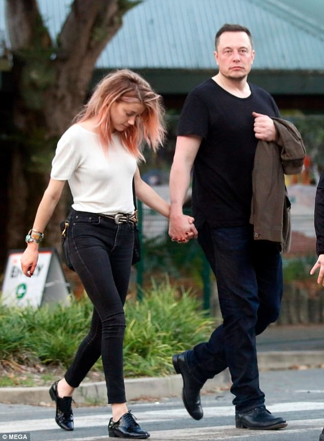 PDA: They were even spotted walking hand-in-hand around the park