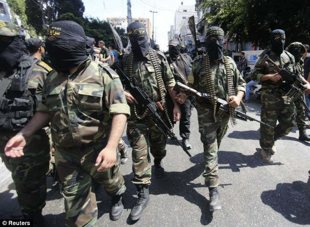 Palestinian Islamic Jihad militants take part in the rally in Gaza City shortly after President Abbas's interview