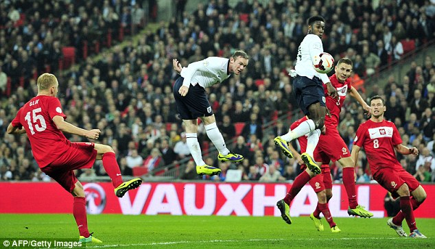 Heads I win: England's Wayne Rooney scores the opening goal against Poland