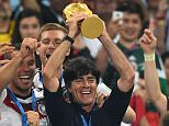Germany manager Joachim Low lifts the World Cup after leading his country to glory in 2014