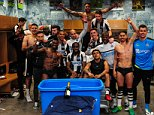 Newcastle United players celebrate in the dressing room after sealing promotion on Monday