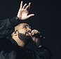 """FILE - In this Aug. 5, 2016, file photo, Drake performs in concert as part of the Summer Sixteen Tour at Madison Square Garden in New York.  Drake was the world's most popular recording artist in 2016, as the growth of music streaming gave global music sales their biggest boost in 20 years. The International Federation of the Phonographic Industry said Tuesday, April 25, 2017 that Drake had the years' best-selling single, with """"One Dance,"""" and the third best-selling album, """"Views.""""  (Photo by Charles Sykes/Invision/AP, File)"""