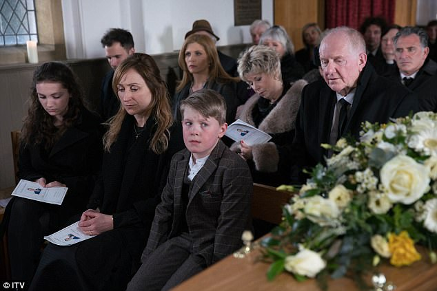 RIP: Finally losing his battle with dementia later this week, family and friends gather in church to pay their respects to the late vicar - fighting back tears as the coffin leads to the front