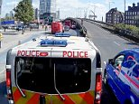 The footage, filmed by Alan Crosby, shows a Metropolitan Police vehicle standing up to a blue van as tries to barge into a slip road in Bow
