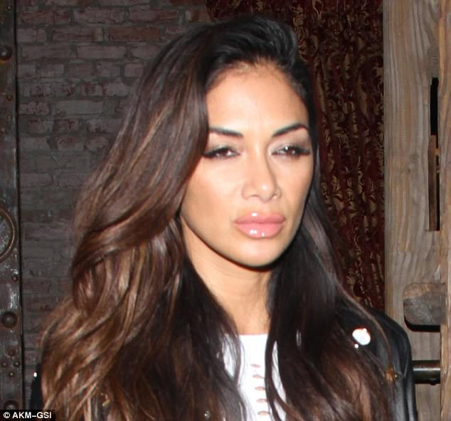 Living it up: The X Factor judge seemed like she had seriously let her hair down at the fashionable venue