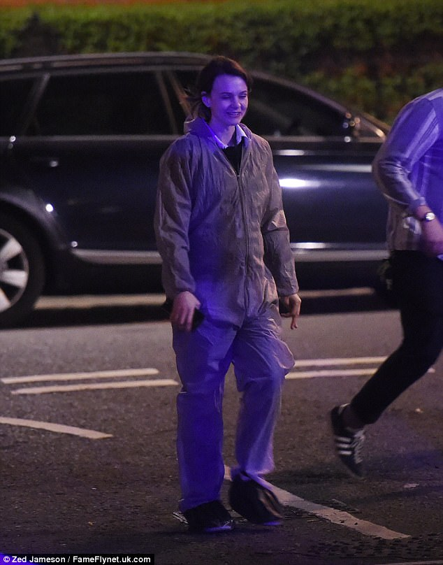 Suited up : The 31-year-old actress donned a grey forensic suit over a white shirt and black sweatshirt