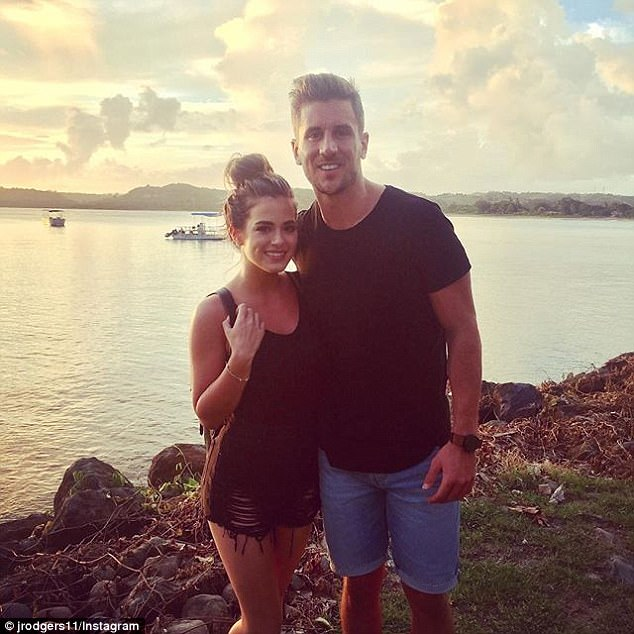 'Can't beat the view':He showcased his musclebound arms in a black T-shirt as he posed alongside JoJo at a cliff offering a spellbinding vista of the ocean at sunset on Friday