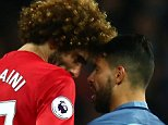 Sergio Aguero falls to the floor clutching his head after Marouane Fellaini had aimed a headbutt at him with six minutes left