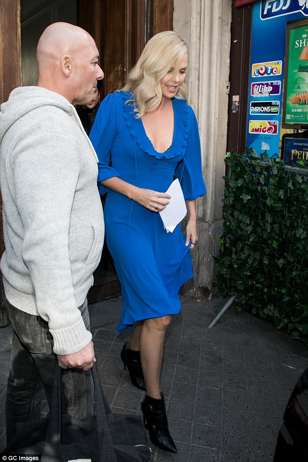 Dressed to impress: The stunning star was seen heading to work in the French capital in a chic blue midi dress, flaunting her long, toned legs, and accessorizing with Eva Fehren jewels