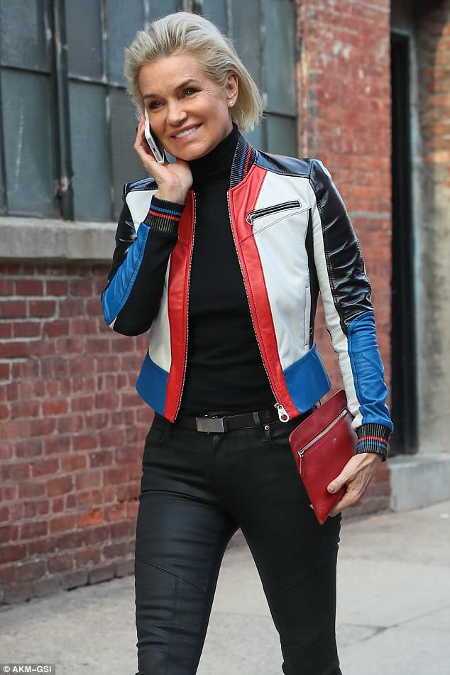 All smiles: The Dutch-native paired the dark jeans with a sleek black turtleneck to keep her main outfit simple and chic