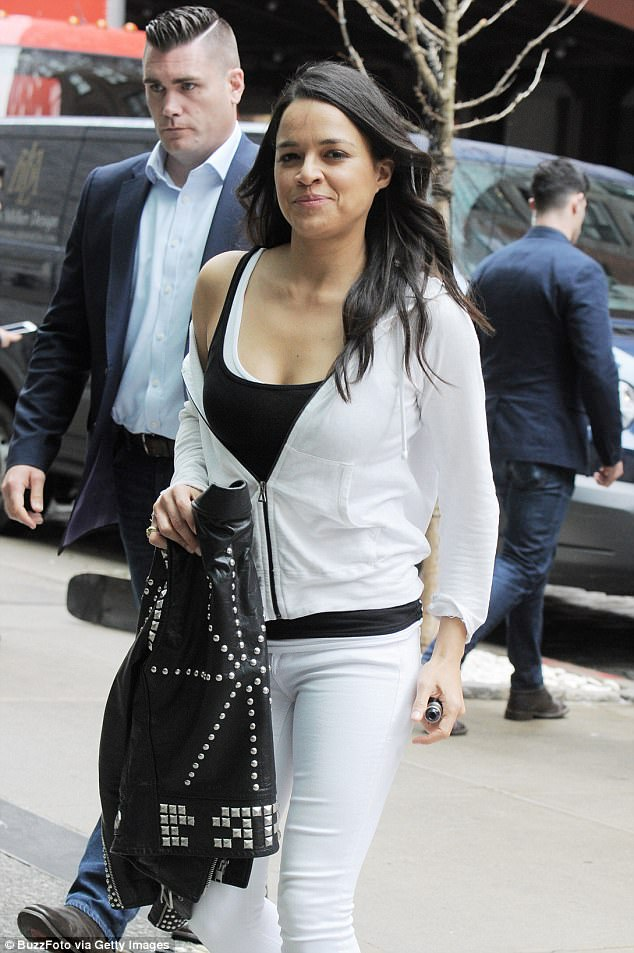The white stuff: However, Michelle clearly found it tricky to ditch her favourite studded jacket