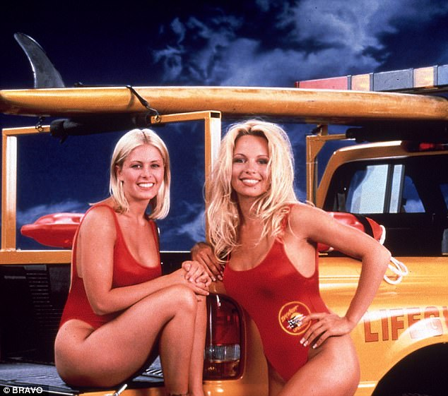 Not aged a day: Pamela (right, with Nicole Eggert) could have stepped straight off the Baywatch set, from the Eighties
