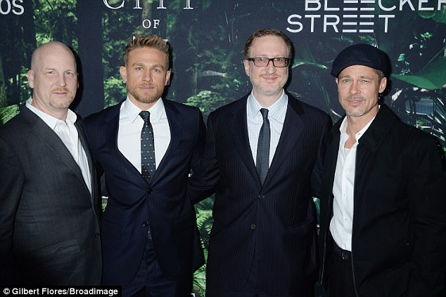Team: Brad was joined on the red carpet by the film's equally handsome lead man, Charlie Hunnam (2nd from L) and director James Day (3rd from L)