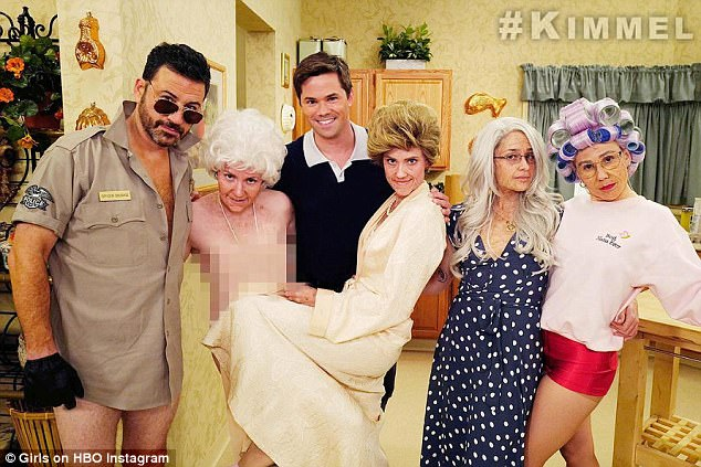 Group shot: The girls from Girls are seen posing with their co-star, Andrew Rannells and TV host Jimmy Kimmel