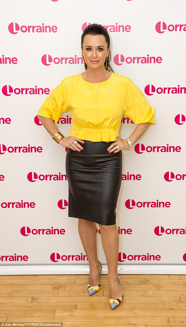 Chic: Kyle sported a bright yellow top, coordinating heels and a leather skirt