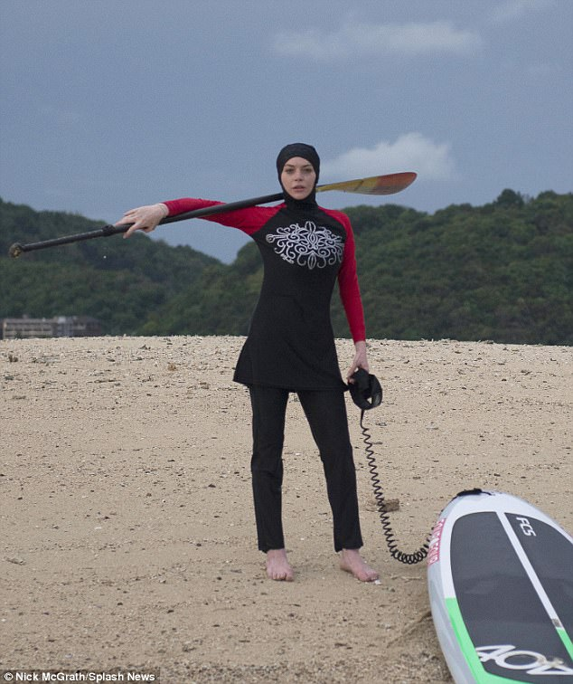 Something a bit different: The actress enjoyed a paddleboarding session in her Burkini