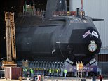 Easy does it! The hugely-proportioned HMS Audacious was taken out of its indoor ship building complex at BAE Systems today