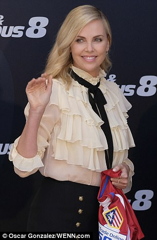 Positively glowing! The Hollywood star boasted a dewy complexion and her blonde locks in soft glamorous waves for the event