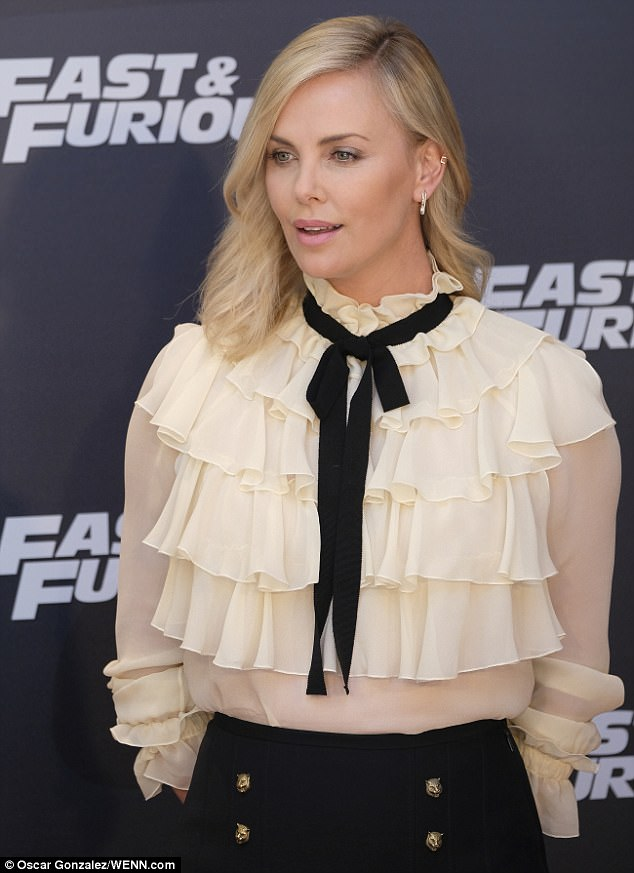 Sensational! The actress, 41, looked chic and elegant in her stylish but simple ensemble, adding a bit of bling with an Eva Fehren ear cuff