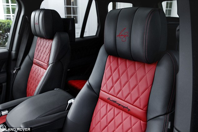 The red and black seats have the champion's signature etched into the headrests