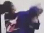 The shocking moment a 12-year-old girl was bashed in a school bathroom by a bully has been captured on camera