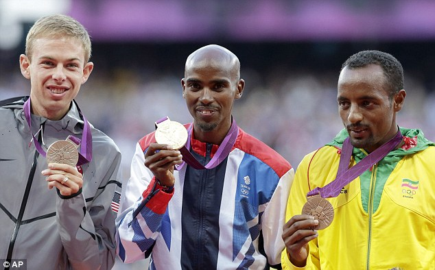 Proud: Mo Farah received the gold medal for the 10,000m on Sunday
