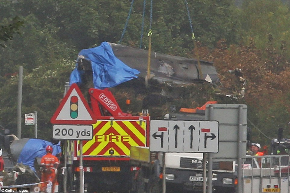 Investigation: The jet is being salvaged so air accident investigators can examine the machinery to see if there was an obvious fault before it crashed into the A27