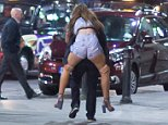 Men and women were seen propping each other up, giving each other piggy backs and dancing in the streets of Liverpool as they celebrated their extra day off