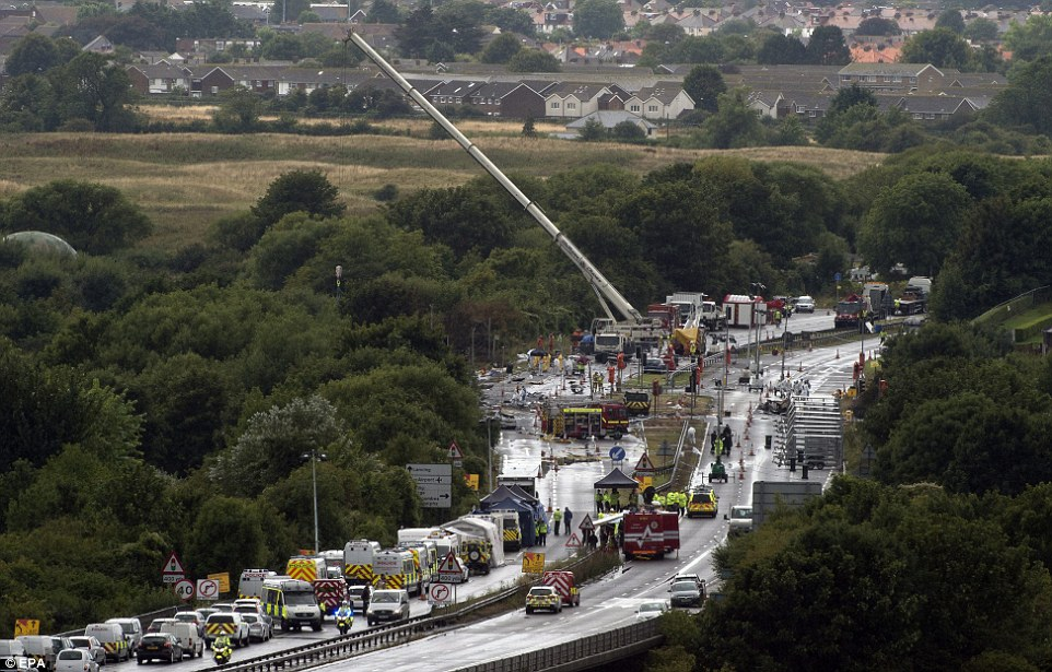 Recovery work: The giant crane spent several hours picking up debris from the dual carriageway, which will remain closed for a number of days