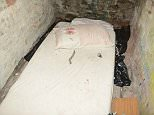 This is the filthy cellar where a pensioner was kept tied up in darkness by an escort and her lover