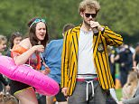 Thousands of Cambridge University students descended on a park today for the annual 'Caesarian Sunday' drinking party