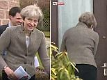 Theresa May walks away from another empty home with her aide shuffling just behind her