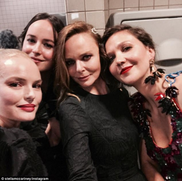 'All goes down in the toilets': The designer also shared a crowded selfie from the bathroom with Maggie Gyllenhaal, Dakota Johnson and Kate Bosworth