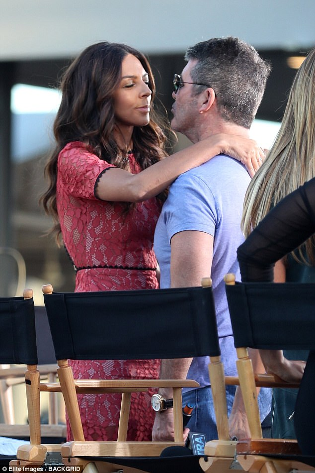 Still friends! Simon Cowell proved he was very much on friendly terms with his ex girlfriend Terri Seymour as they cosied up on the set of EXTRA in Los Angeles on Monday, where the musical mogul was promoting the new season of America's Got Talent
