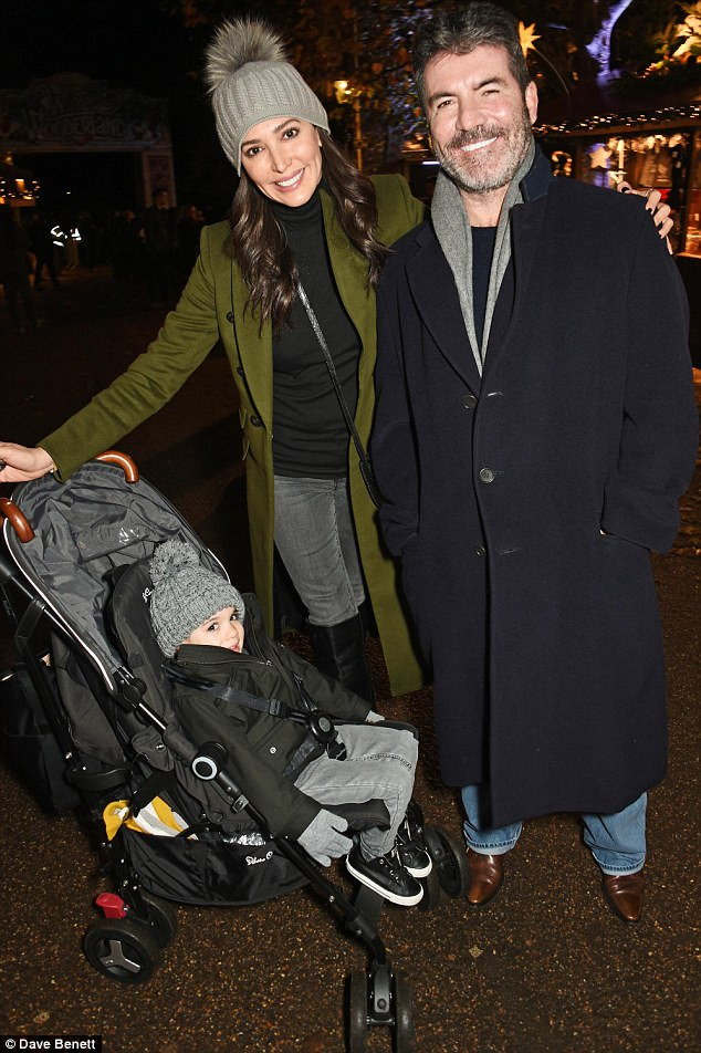 Moving on: Simon shocked fans in summer 2013 when it was revealed he was expecting his first child with American socialite Lauren - who was then married to real estate mogul Andrew Silverman