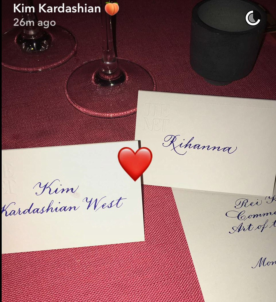 Look who I am sitting with: She may have been without a date for the night but Kim did have some good company at her table