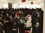 Women were seen desperately grabbing clothes during a sale at a department store in Saudi Arabia